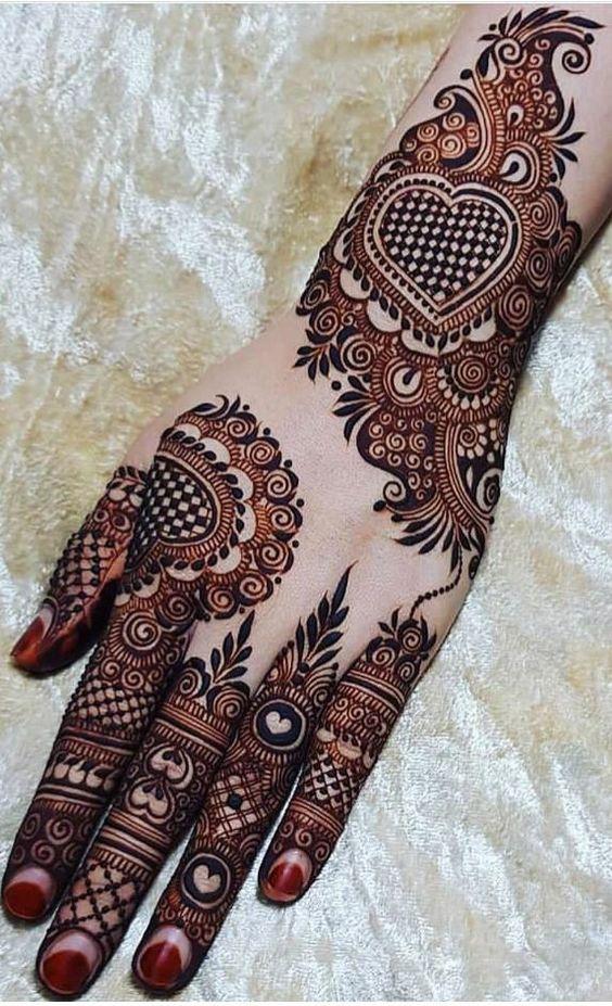 arabic back hand mehndi design by glossnglitters