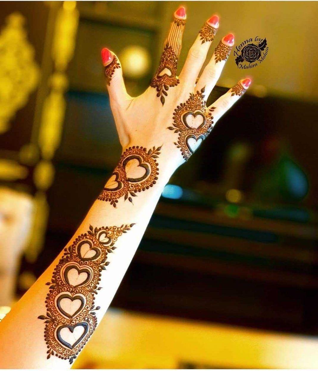 backhand mehndi design hearts